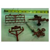 4 vintage red metal farm implements