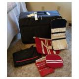 American Tourister suitcase and 2 duffel bags