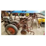 David Bradley tractor with cultivators,