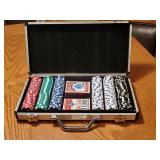 Set of clay poker chips in metal case