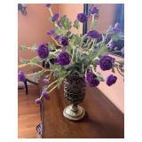 Purple floral arrangement in metal vase