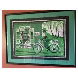 Framed tropical print, bicycle rider
