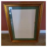 Gold colored ornate picture frame