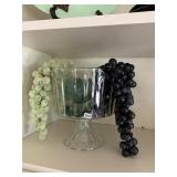 Glass & metal bowl with grapes, column