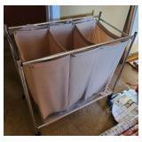 Laundry hamper on metal frame, casters
