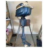 Evinrude boat motor and stand