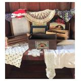 Small wooden boxes cookbooks and doilies