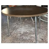 Round Formica tip table with metal legs