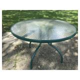Green frame round glass top patio table