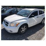 2008 Dodge Caliber.  Tinted windows, am/fm radio.