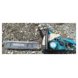 MAKITA gas powered hand held saw