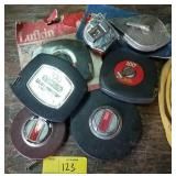 Lot of long tape measures and more