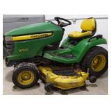 John Deere X500 Multi-Terrain ridding lawnmower.