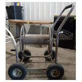 Heavy- duty hose reel. On metal rolling cart with