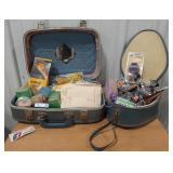 Small vintage suitcase and carry on filled with