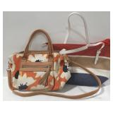 Floral Relic purse in orange, tan and black has