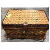 Wicker picnic basket with cups, plates, utensils