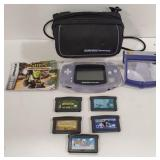 Game Boy Advance with case, 5 games, and