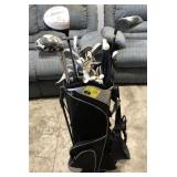 Golf clubs and shoulder caddy with gloves and