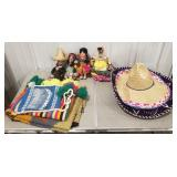 Lot of Mexican dolls, hats, and blankets