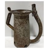 Vintage rustic metal oil can.