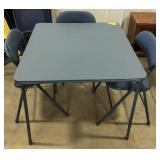 Folding padded Card table and 3 padded chairs.
