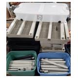 Large lot of plastic storage shelves and tote.