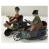 (2) Hand Painted Tin Toy Sold tiles the money