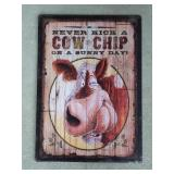Never Kick A Cow Chip On A Sunny Day Tin Embossed
