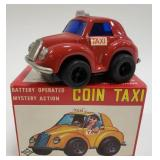 Tin Battery Operated Mystery Action Coin Taxi