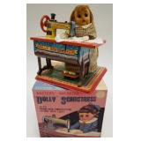 T.N Japan Tin Battery OP. Dolly Seamstress with