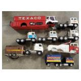 Lot of Ertl, Nylint, and Texaco Trucks. Some for