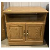 "Wooden tv stand measures 28""H x 29.5""L x 19""W"