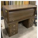 "Wooden roll top desk measures 46.5""T x 58""L x"