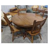 "48"" round oak table and 4 chairs"