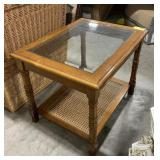 Wooden framed end table with glass top and wicker