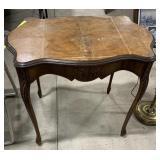 "Wooden decorative table measures 29""T x 33""L x"