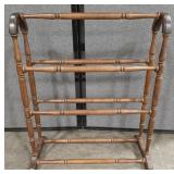 Wood quilt rack.
