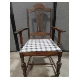Vtg wood arm chair with padded seat.