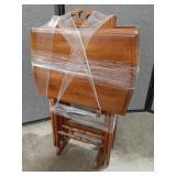 Set of 4 folding table TV trays on rack.