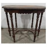 "Ornate carved wood table. Needs refinished. 29"" T"