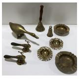 Lot of brass trinkets, birds, bells and ashtrays.