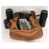 Leather camera bag with Konica film camera,