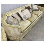 Vintage yellow bowed arm couch