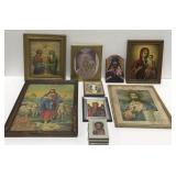 Lot of framed religious pictures.