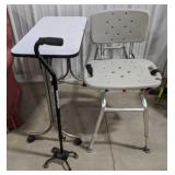 Shower seat with strap, white table on wheels and