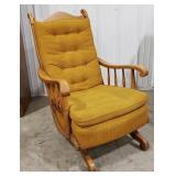 Rocking chair, mustard colored upholstery,