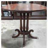 Oval accent pedastal table, one foot is damaged,