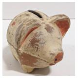 Vintage painted clay piggy bank. Measures 5