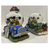 The Disney store Mickey and Minnie snow globes